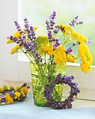 Achillea and lavender in green vase