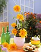 Arrangement of orange dahlias
