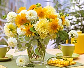 An arrangement of dahlias and sunflowers