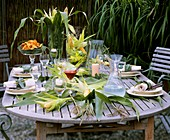 Autumnal table with sweetcorn decoration, taco chips and dip