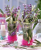 Lavender and olive branches in vases