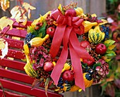 Wreath of pumpkins, apples, Guelder rose berries, hydrangeas