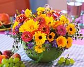 Summer arrangement of marigolds, zinnias and borage