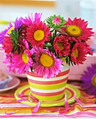 Asters in a cup and saucer