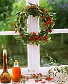 Wreath of olive branches and rose hips