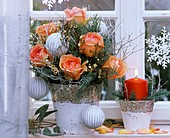Christmas arrangement of roses, cypress and bilberry foliage