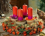 Physalis Advent wreath and terracotta pots with spices
