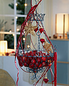 Wire basket decorated for Advent with red apples