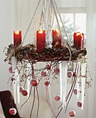 Hanging Advent wreath with ornamental apples and cones