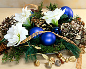 Arrangement of amaryllis flowers, greenery & Christmas baubles