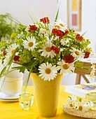 Vase of marguerites, geums and lady's mantle
