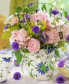 Arrangement of peonies, lady's mantle and cornflowers