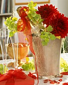 Champagne cooler with champagne bottle, Bells of Ireland & dahlias