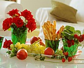 Tray with grapes, raspberries, strawberries, cheese straws