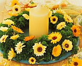 Wreath of parsley with marigolds and a candle