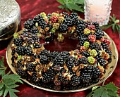 Blackberry wreath on gold plate