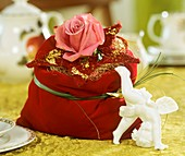 Velvet bag with rose, star and angel's hair
