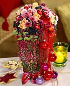 Arrangement of chrysanthemums, roses, apples, baubles