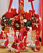 Hanging Advent wreath (Advent calendar) with red ribbons
