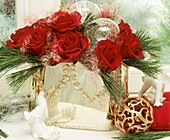 Silver vase with red roses, Eastern white pine & angel's hair
