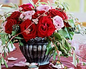 Arrangement of red & pink roses with ivy & olive branches
