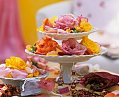 Rose potpourri on tiered stand and plate, for scented bags