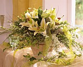 Flower arrangement with lilies for special occasion