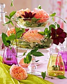 Layered stand composed of two glass bowls with roses & clematis