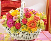 Basket of zinnias, dill and Tagetes