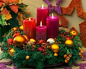 Advent wreath of Noble fir and rose hips