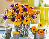 Marigolds, cornflowers, lady's mantle and chamomile in bucket