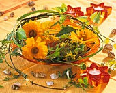 Coreopsis, lady's mantle and prairie cordgrass in a bowl