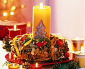Advent wreath with ornamental apples, nuts and cones