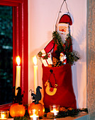 Father Christmas with sack filled with fir and gifts