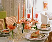 Laid table with Amaryllis, crystal bowls and salmon