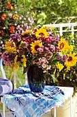 Autumn arrangement: sunflowers, Michaelmas daisies & golden rod