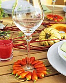 Ornamental peppers as wine glass decoration