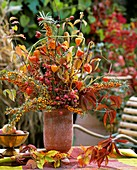 Autumn arrangement of sea buckthorn and European spindle