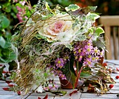 Autumn wreath of ornamental cabbage and Michaelmas daisies