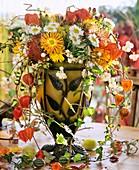 Glass vase of chrysanthemums, Chinese lanterns and Hypericum