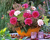 Arrangement of carnations and smoke tree flowers in basket