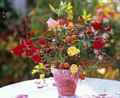 Arrangement of roses and rose hips