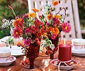 Table decoration: Chrysanthemums, Michaelmas daisy, rose hip, borage