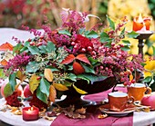 Erica, ivy (Hedera), blackberry shoots, carnations (Dianthus)