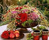 Arrangement of red roses, ornamental cabbage & privet berries