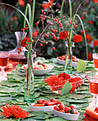 Table decoration: pipevine leaves, peppers & dahlias