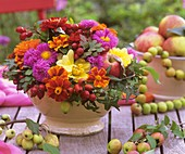 Autumn arrangement of Tagetes, asters, dahlias