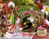 Autumn table decoration: moss, Erica and ornamental peppers