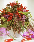 Autumnal arrangement of heather and ornamental peppers