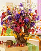 Autumnal arrangement in wicker basket